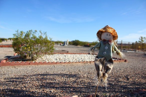 On this day, I saw three scarecrows on graves. Three!