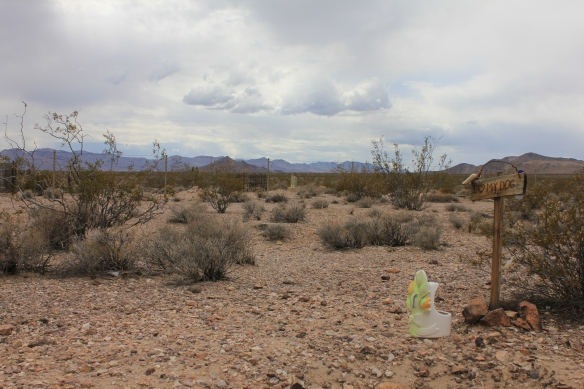 Just outside of the cemetery fence in Rhyolite...
